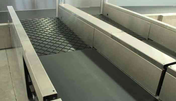 In-motion conveyor weighing system Image